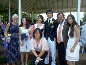 Marcy and Jim Heffinger are shown with some exchange students at graduation.