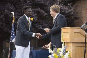 Student receives his diploma