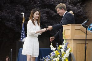 Student receives her diploma